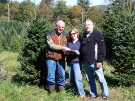 Case Pieterman, Cindy DeMarco and Steve Strickland select Christmas Trees for the Club's annual Christmas Tree sale.